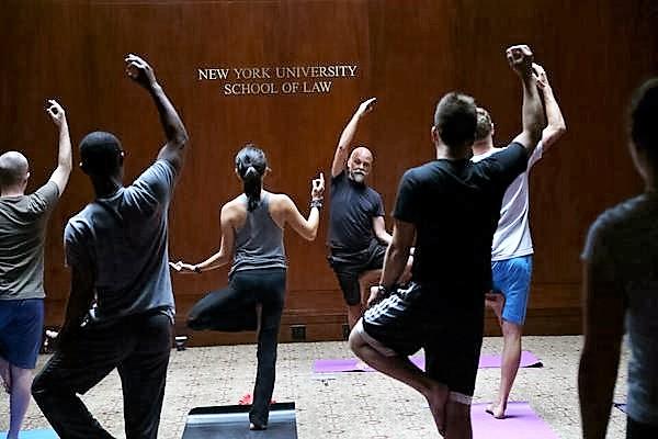 Students practicing yoga at NYU Law.